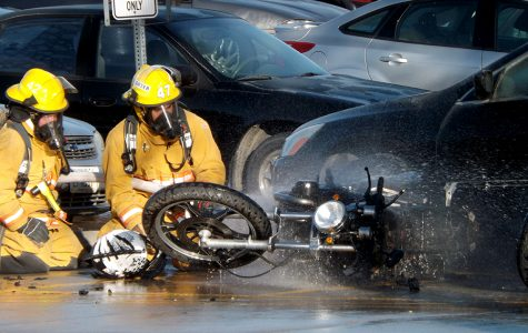 Motorcyle catches fire in parking lot 10