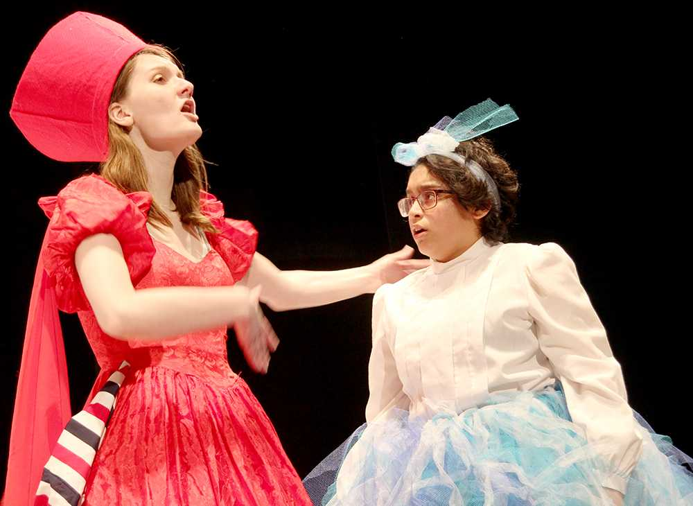 """Junior Anna Kruger created all the costumes for the spring show """"Alice's Adventures in Wonderland."""" The Red Queen (Hope Pedersen) tells Alice (Dulce Torres) that she could be a queen."""