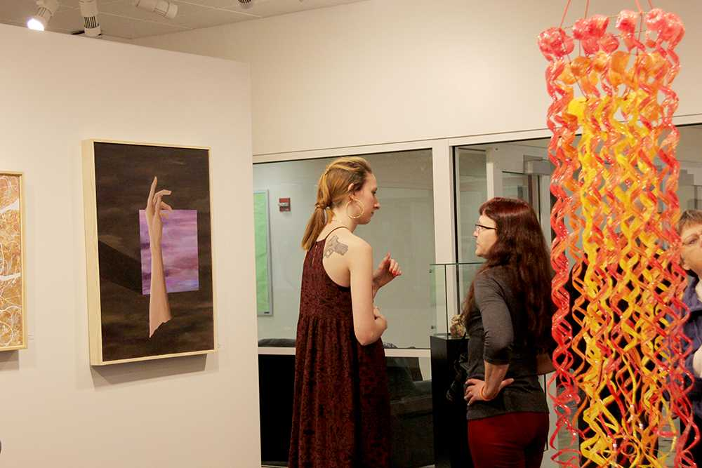 "Senior Amy Widger talking about her artwork that is featured in the ""Residuum"" senior art exhibit."