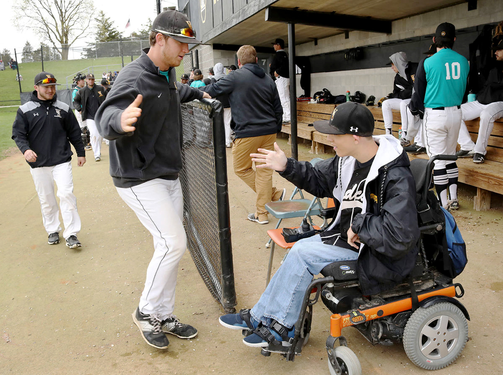 The Wildcats baseball team welcome Jess Gibson into the dugout during Thurdsay's game against Upper Iowa University. Gibson is part of the Team Impact organization that pairs children with disabilities or who face chronic or life-threatening illnesses with a college athletic team. Gibson chose to be part of WSC's baseball team, where he participated in a signing ceremony on March 27. Gibson was presented with a black-and-gold Wildcat jersey, number three, and has become an established player, attending both practices and games.