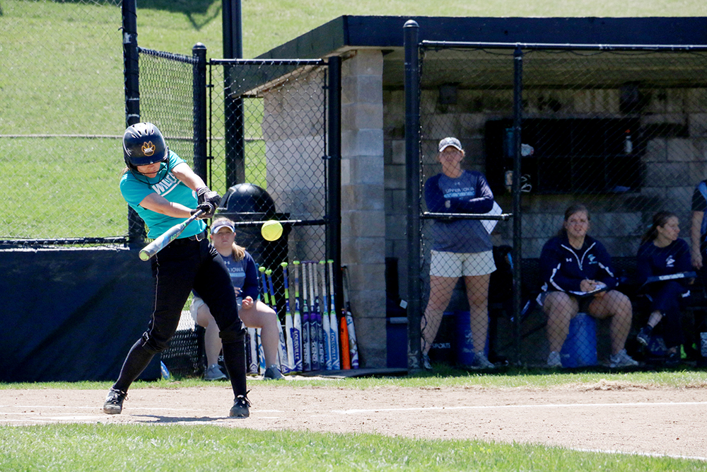 """Senior Monique Alyea hits against the Peacocks in Tuesday's """"Fill the Hill"""" game. Alyea went 6 for 7 on the day with two RBIs. WSC wore teal jerseys for the games to raise awareness for Sexual Assault month."""