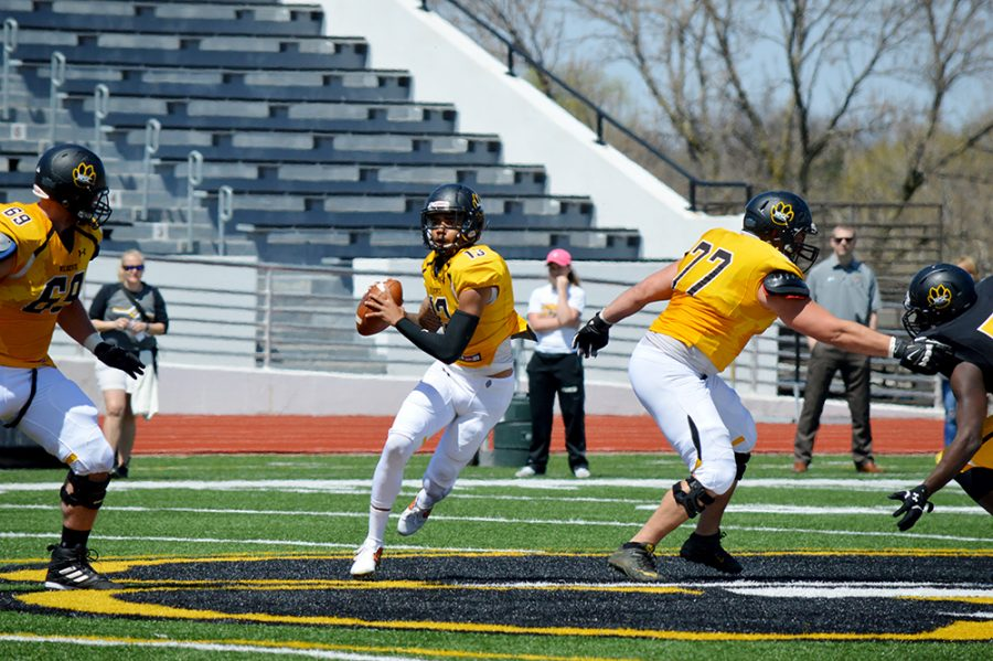 WSC%E2%80%99s+football+team+hosted+its+annual+spring+football+game+Saturday.+The+game+is+a+scrimmage+against+the+Gold+team+%28offense%29+and+the+Black+team+%28defense%29.+The+Gold+team+came+from+22+points+down+to+rally+back+and+take+the+win+from+the+Black+team+with+a+final+score+of+31-30.+The+spring+game+concludes+spring+drills+for+the+Wildcat+football+team+until+the+summer.+