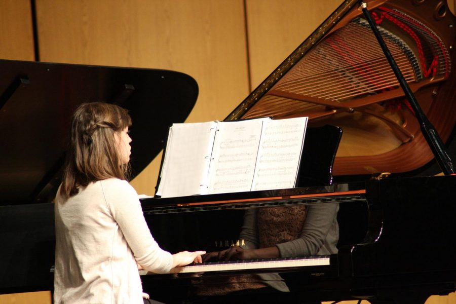 """Emily Moore performed with the Wayne State piano ensemble in Ramsey Theater last Thursday night. She also played """"The Stars and Stripes Forever"""" with Jaicee Heng."""
