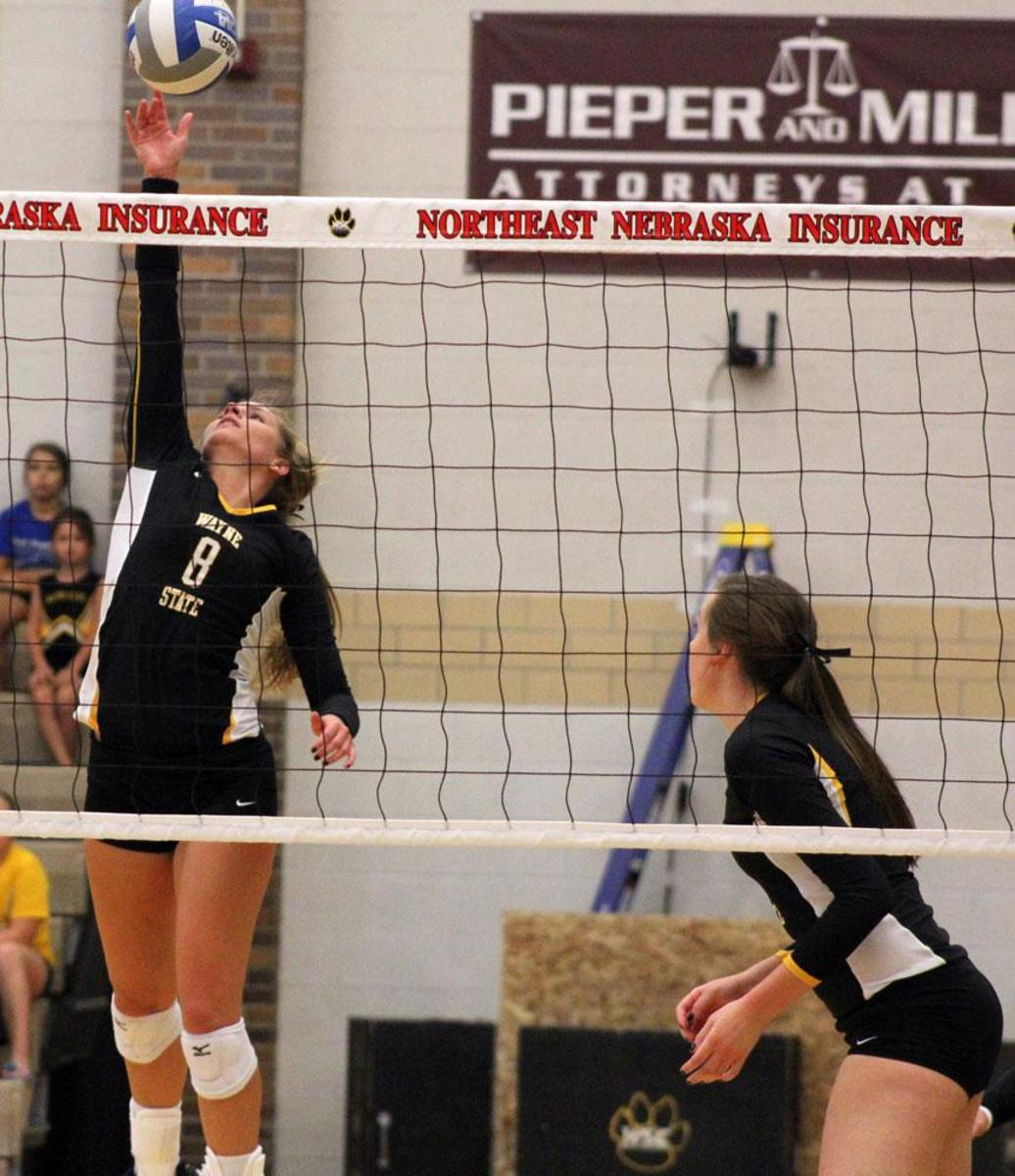 Katie Hughes collects a kill in a match earlier in the year. She led the team last night with 15 kills.