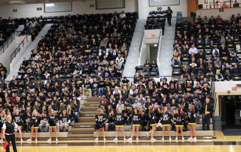 A crowd of 1,216 Wildcat volleyball fans takes in the annual Blackout/Pack The House night against Augustana. It was the fourth-largest crowd in history for Wayne State.