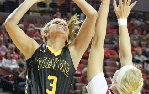 Alex Nelson drives to the basket and puts up a shot over a Nebraska defender in a 84-43 win for the Huskers.
