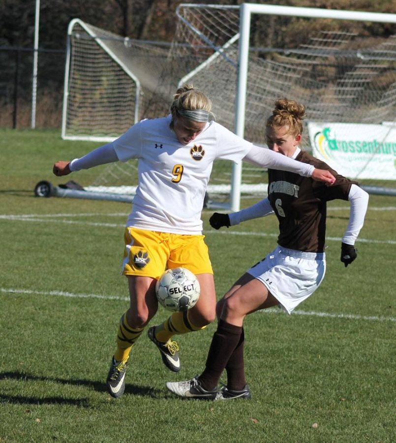 Josie Brown fights for a ball against a Southwest Minnesota State player. Bottom: Mallory Hoyt kicks the ball to a teammate in last Friday's loss to Southwest Minnesota State.