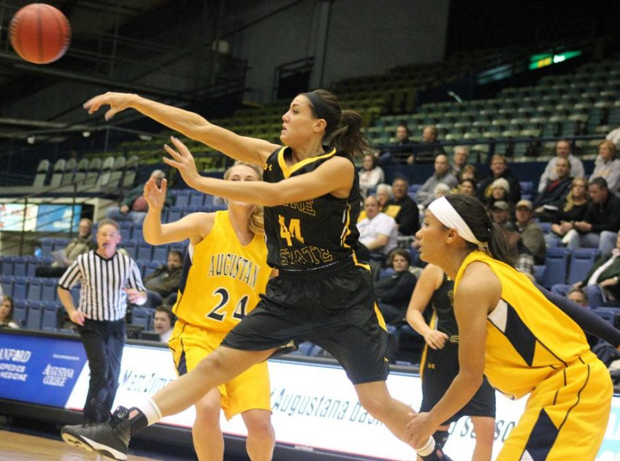 Jordan Spencer takes flight while passing the ball to a teammate in Wayne State's 71-57 win over Augustana in Sioux Falls on Nov. 24.