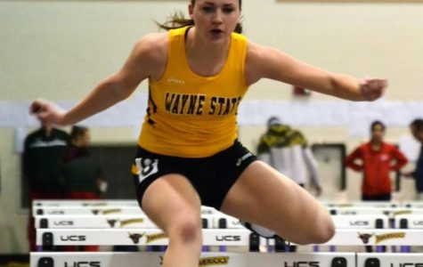 Kelsey Dietrich hurdles her way to a time of 9.66 seconds in the 60 meter hurdles.