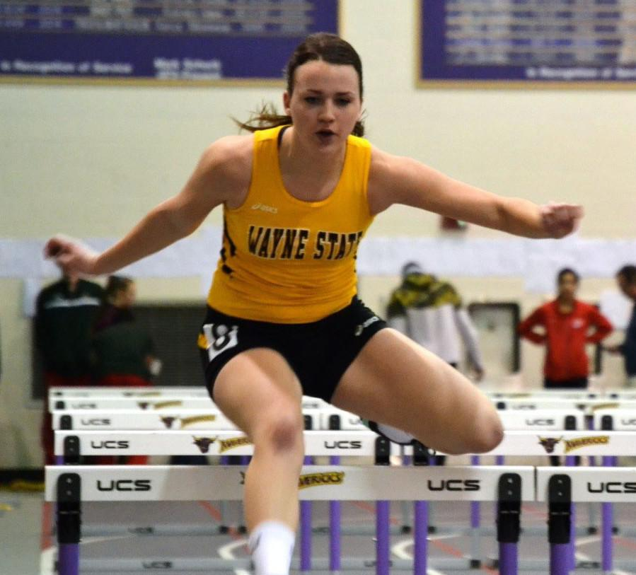 Kelsey+Dietrich+hurdles+her+way+to+a+time+of+9.66+seconds+in+the+60+meter+hurdles.