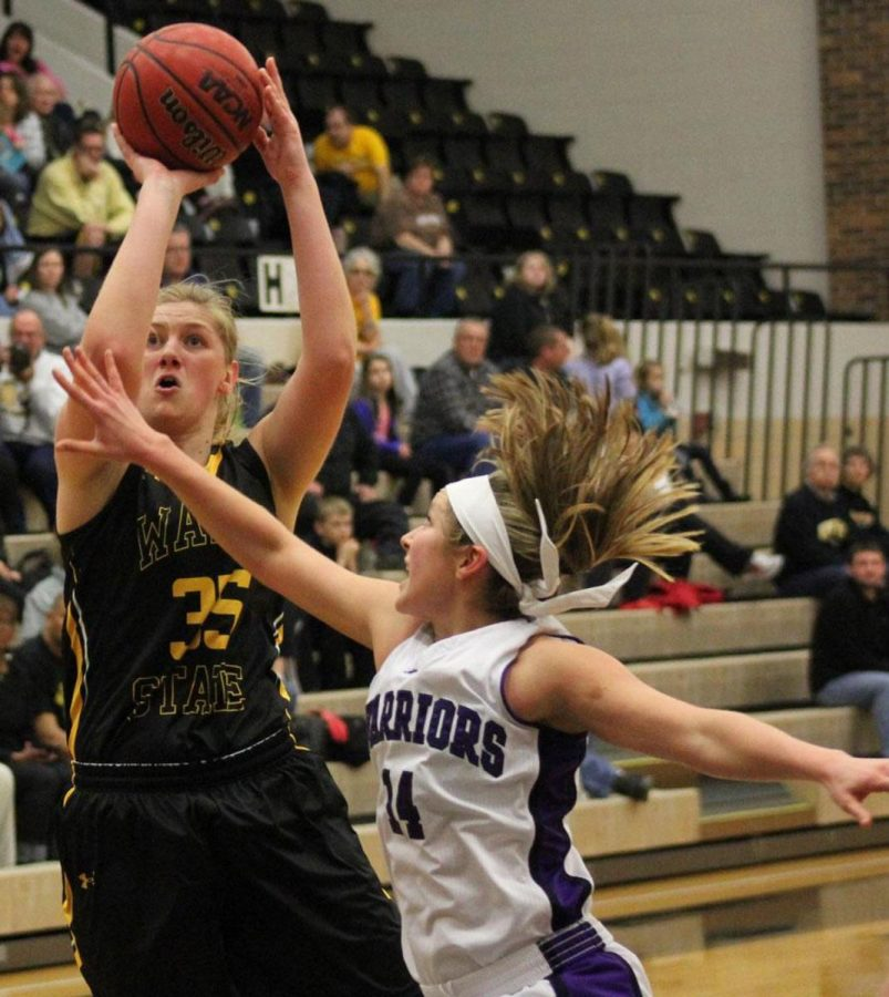 Maggie Schulte aims for the basket in Wayne State's 64-44 victory over Winona State. Wayne State, with the two wins, took control of first place in the NSIC south division.