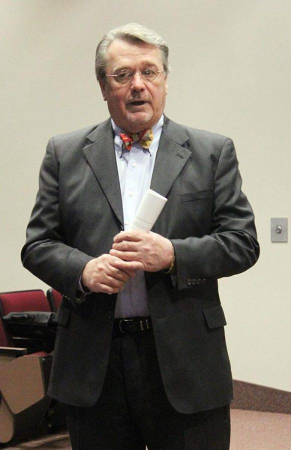 Stan Carpenter introduces Charles Bunting at a community meeting Tuesday morning at Gardner Hall.