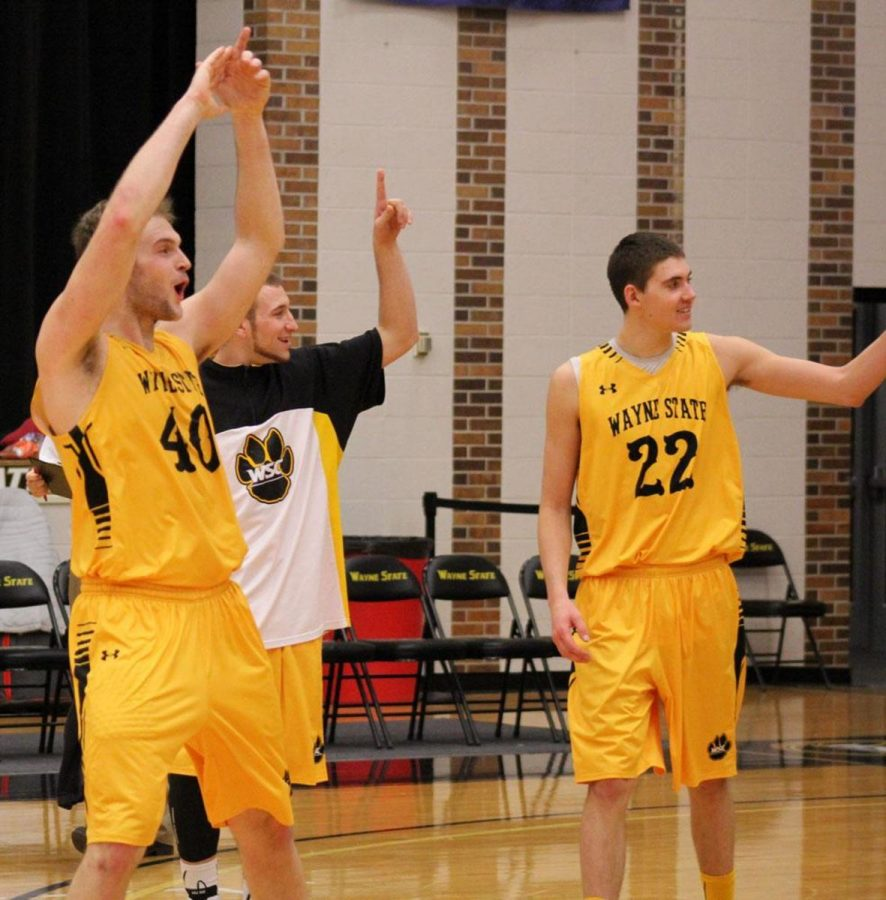 Patrick Kurth and Jordan Cornelius celebrate their first conference win at home earlier in the year. Wayne State won it's second conference game last weekend on a last-second buzzer-beater by Trae Vandeburg.
