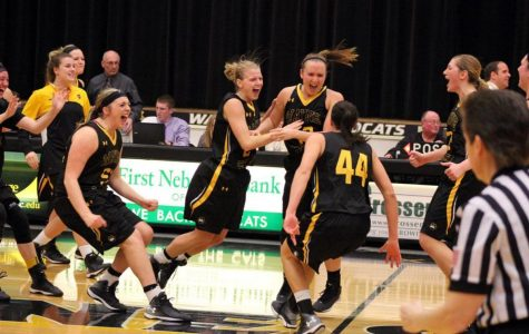 The Wayne State women's basketball team celebrates at midcourt after defeating Northern State 58-57 in thrilling fashion to take a commanding lead in the NSIC Standings. Jordan Spencer scored on a layup with less than 30 seconds remaining to seal the win.