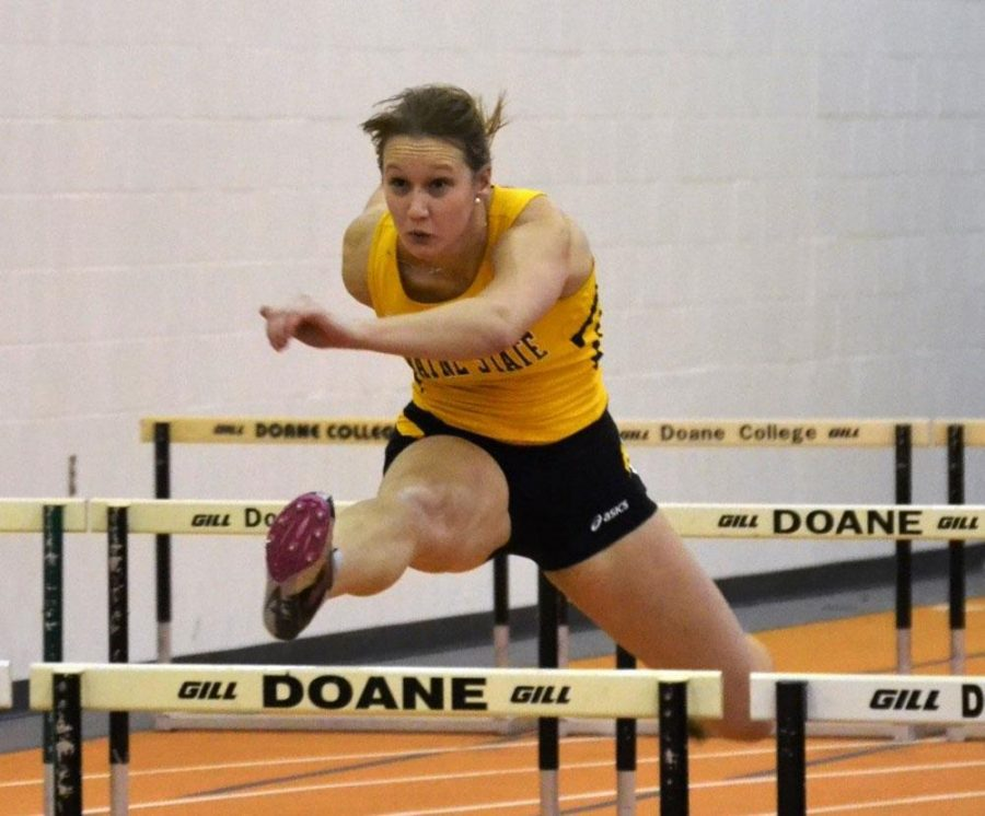 Megan Svitak charges hard over the hurdles to a second place finish with a time of 9.08 seconds.