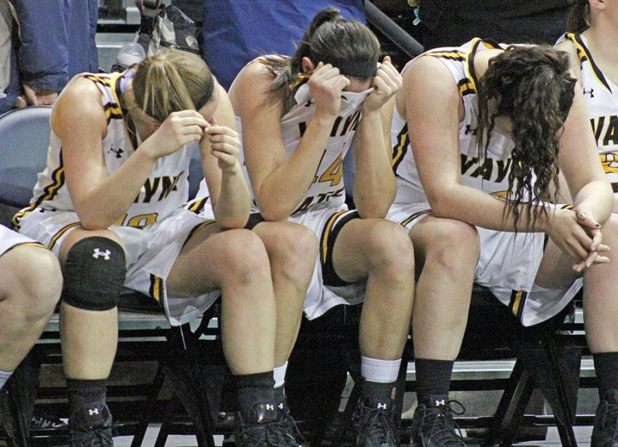 Seniors Ashton Yossi, Jordan Spencer and Millie Niggeling show distress as the final horn sounds in WSC's 61-45 loss to Northern State in the NSIC tournament finals.
