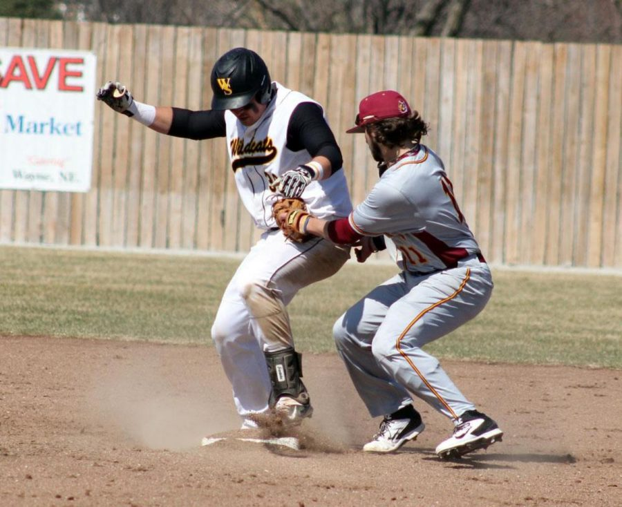 Albert Johnson comes sliding into second base as Northern's second baseman applies a tag.