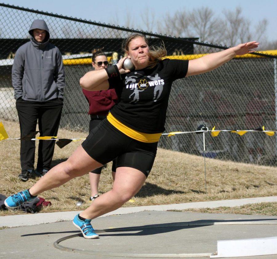 """Sara Wells winds up for a toss in last weekend's shot put on a meet-winning toss of 51' 10 ½""""."""