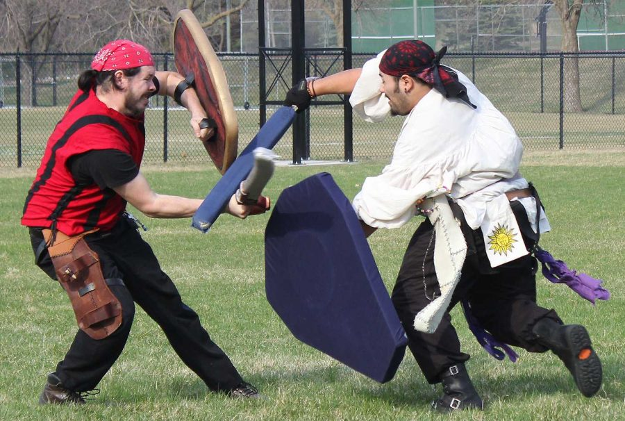Two men engage in a man-to-man battle by the soccer field in the LARP (Live Action Role Playing) event held at WillyCon XVII.