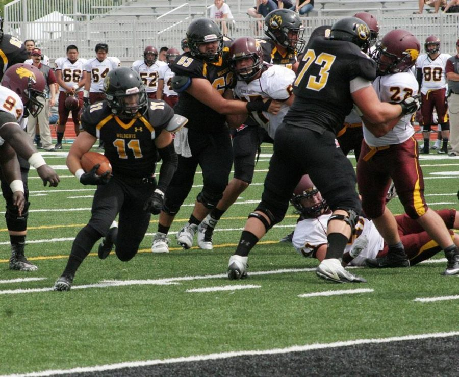 Sophomore Lane Yates rushes past the line for a 9-yard run on Saturday's game against Minnesota-Crookston.