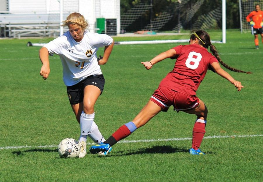 Natalie Rech deflects Northern State midfielder Kay Hernandez's reach for the ball on Saturday's game.