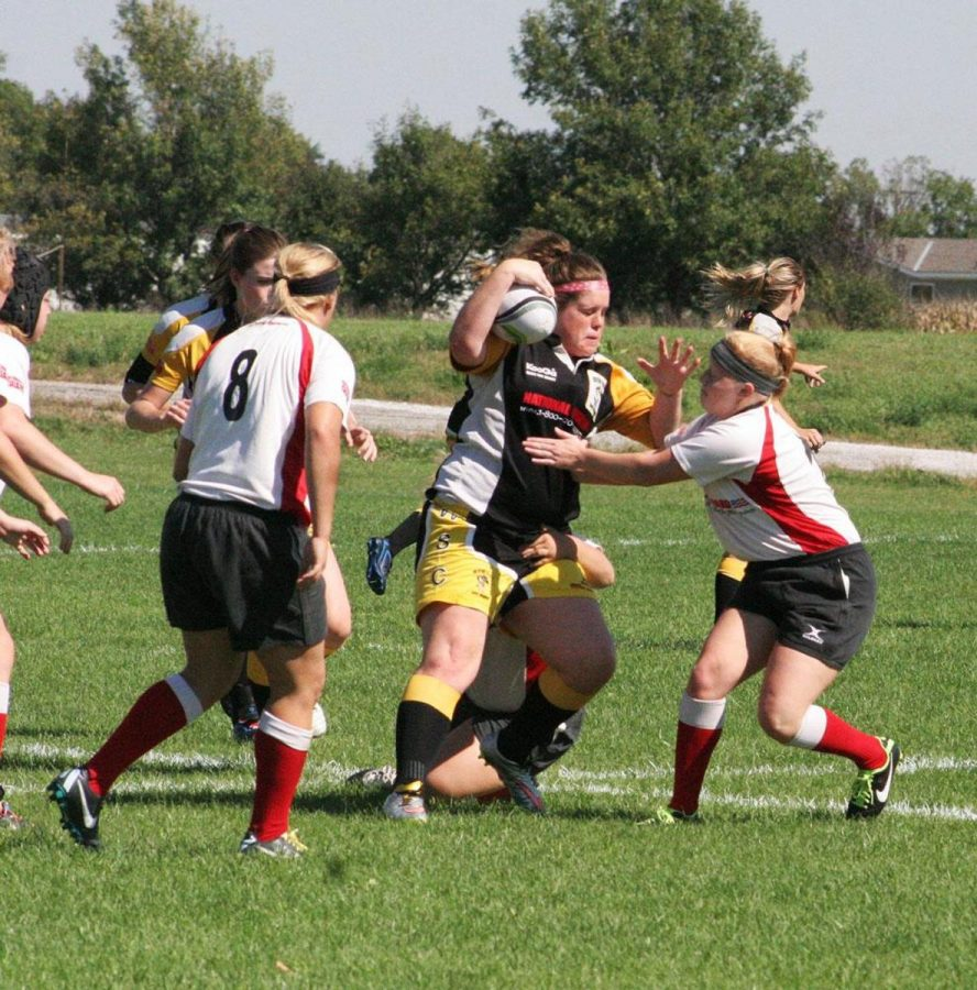 """Wayne State Rugby shows the University of South Dakota why the Wildcats' home field is known as """"The House of Pain."""""""