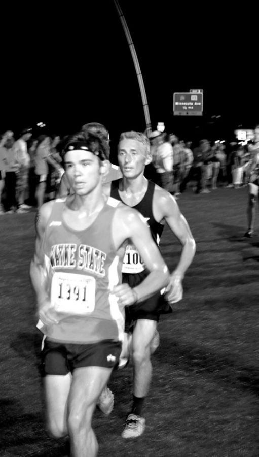 Mens and Womens Cross Country participate in the Augustana Twilight invitational. Justin Brueggemann is featured.