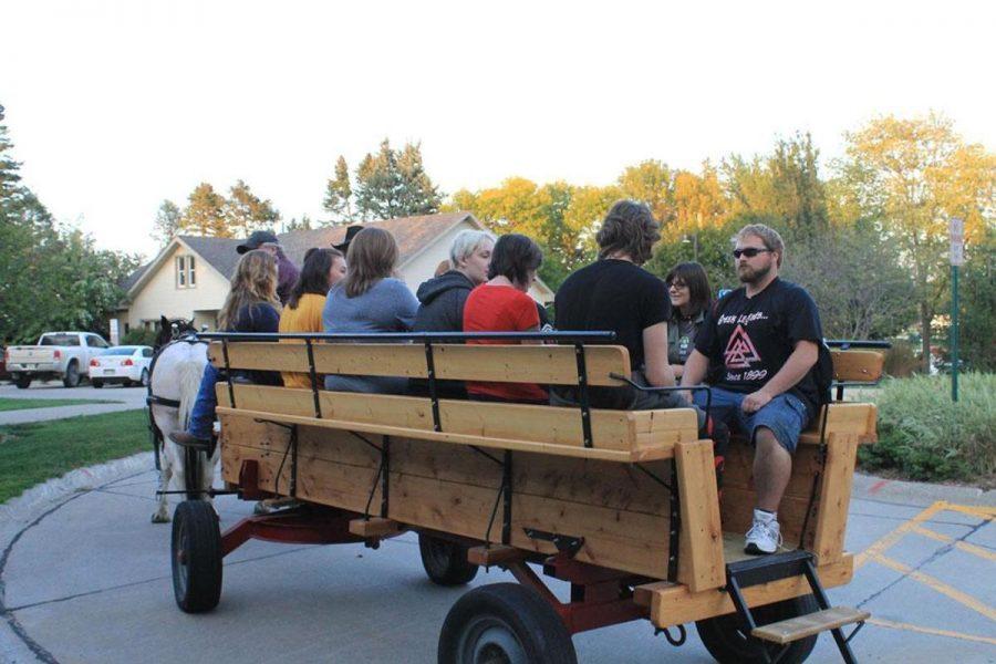 Students rode on horse drawn hayrack ride around campus.