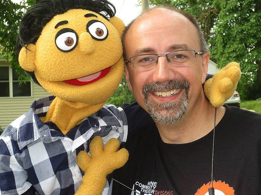 JOHN DUNNING was photographed with one of the puppets he voiced for during a Wayne Community Theatre production.