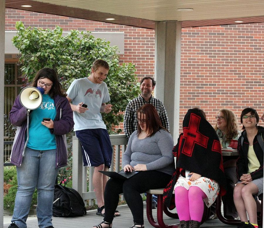 The WSC Writing Club read aloud fiction, non-fiction and poetry in front of the Kanter Student Center for Artswalk.