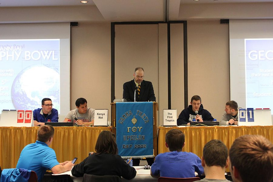 Geography bowl teams of two went head-to-head, answering trivia questions. Left side was team Kenya Not, Grant Harding and Alan Lopez. Moderating in the middle was Dr. Randy Bertolas, and the right side was team The Flint Tropics, Jacob Hord and Kyle Kremer.