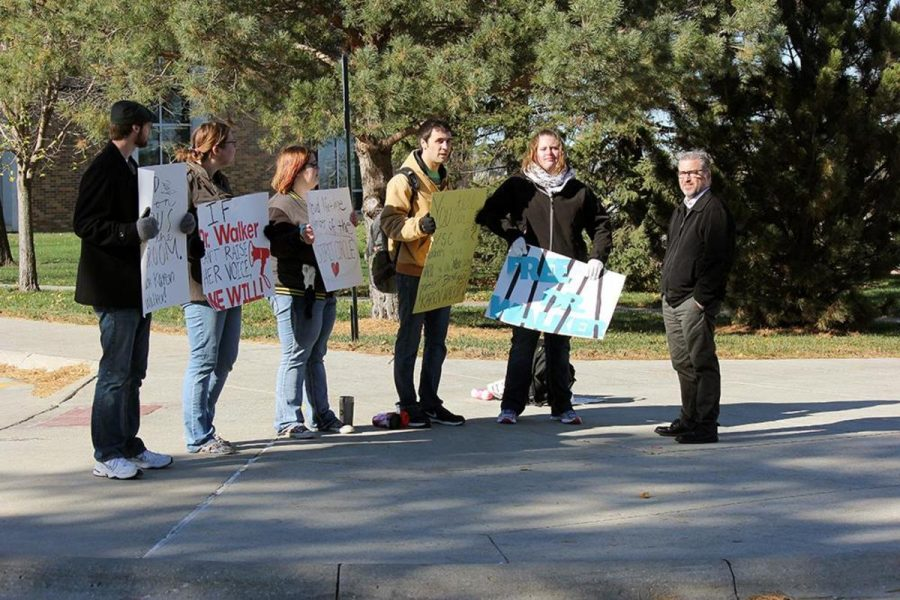 Michael Bogner, Susan Westerhaus, Faith Sheldon, Nathan Neary, Ciera Afrank and professor Mark Leeper were among the group of protesters that stood outside for seven hours in support of dismissed professor Dr. Karen Walker.