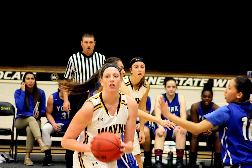 Redshirt freshman Taylor Reiner goes for a shot in the 112-48 blow out against York College on Nov 19.