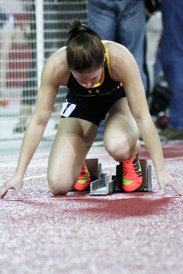 Rachel Rauner sets up for the 60-meter dash in the 2016 Dakota Reality Alumni meet in Vermillion, S.D. this past weekend.