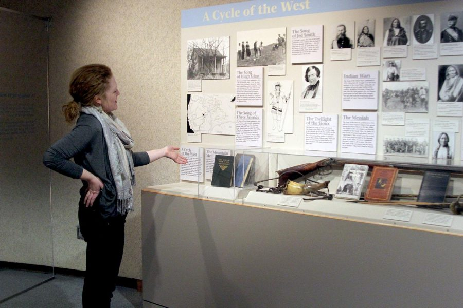 """Amy Kucera, executive director of the Neihardt State Historic Site, pointed to some historical artifacts from John G. Neihardt's time. Neihardt wrote an epic, """"The Song of Hugh Glass,"""" in 1915"""