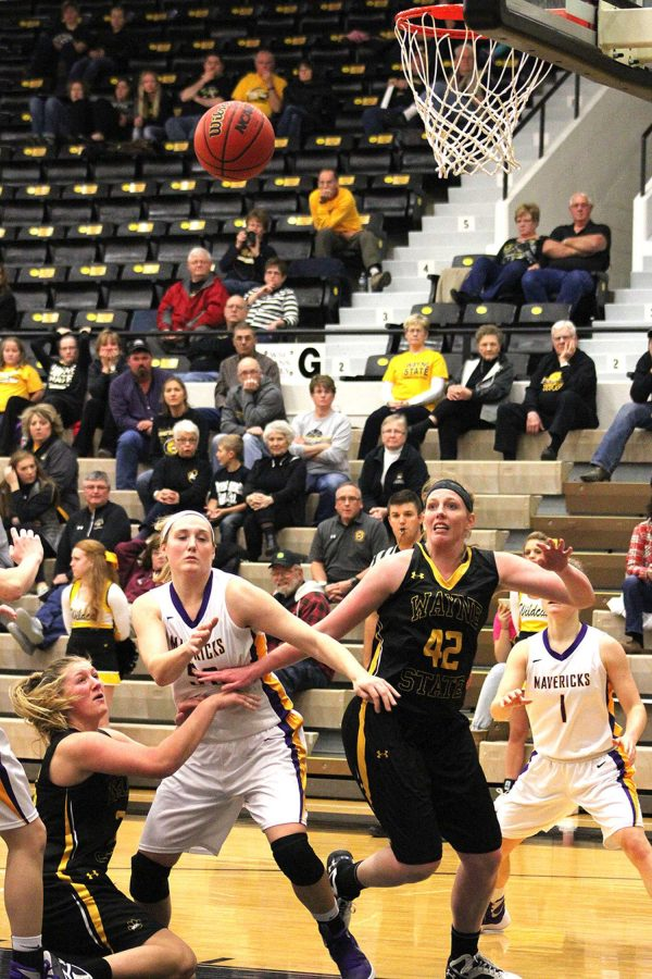 Center Taylor Reiner is pictured above boxing-out a Maverick player for an anticipated rebound. The Lady Wildcats played Minnesota State-Mankato on Dec. 4th in Rice Auditorium.