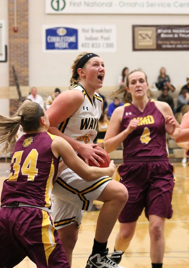 WSC's Maggie Schulte holds on to the ball as Minnesota Duluth's Taylor Dillinger attempts to gain control of the ball.