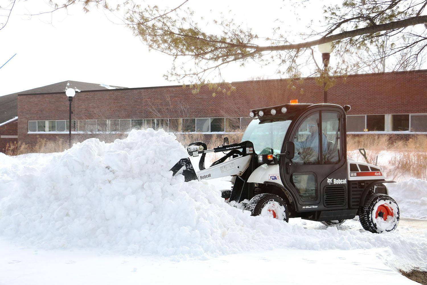 A WSC staff member removes snow from the walkways on campus. With 17.5 inches of snow, there were no classes on Feb. 1 and Feb. 2 for the first time in two decades.