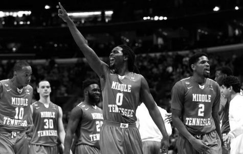 Darnell Harris celebrates Middle Tenessee's victory over Michigan State in the first round of NCAA Basketball tournament. After the Blue Raiders beat MSU 90-81 (and Little Rock's victory over Purdue), CBS Sports reported that less than 1 percent of fan brackets remained perfect.