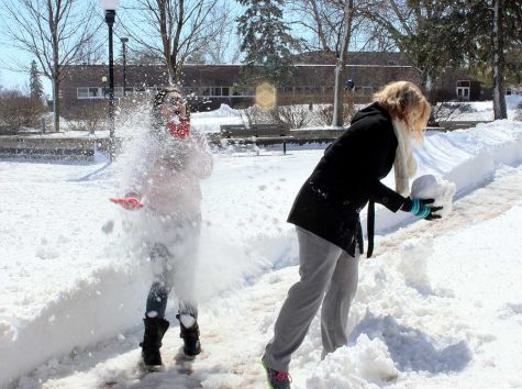 WSC students Alyssa Seamann was hit in the face by a snowball while Dani Isom prepares another snowball for another round.