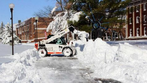 WSC staff use machinery to scoop out the sidewalks around campus.
