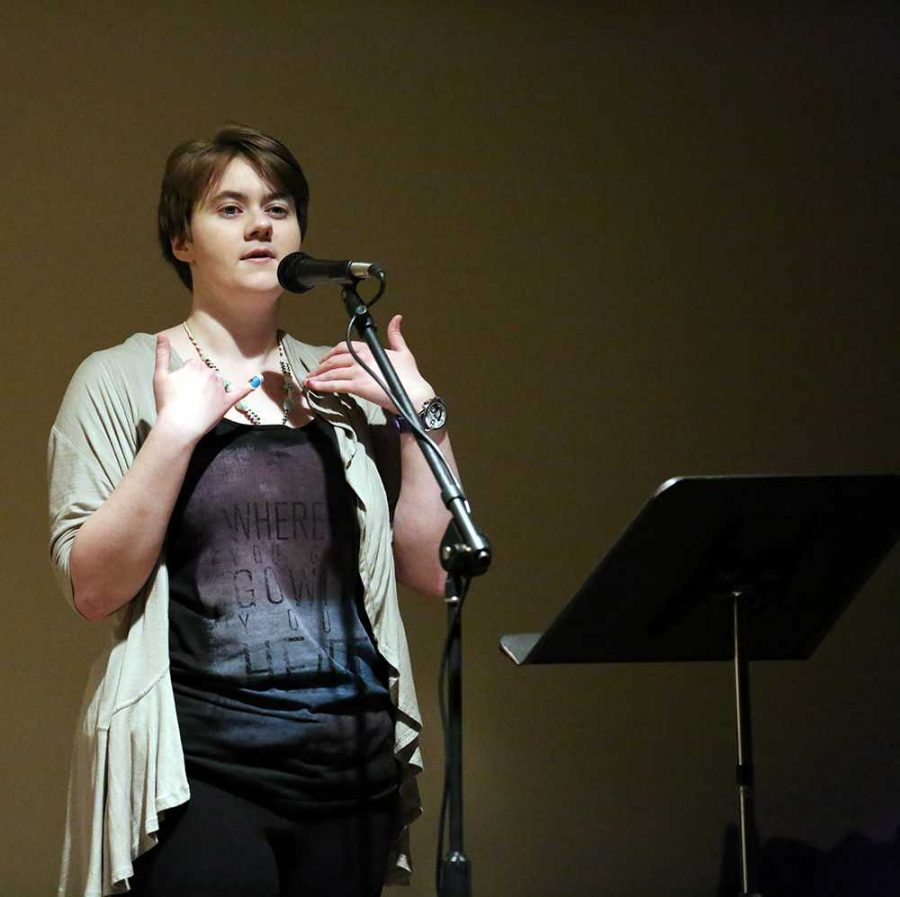 Kelly Weber, a graduate student, was named the Sacrificial Goat of the Poetry Slam.  There were over 30 contestants who read poems about various topics.