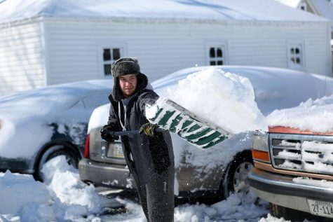 WSC student Jared Guthrie shovels snow out of the way to his car.