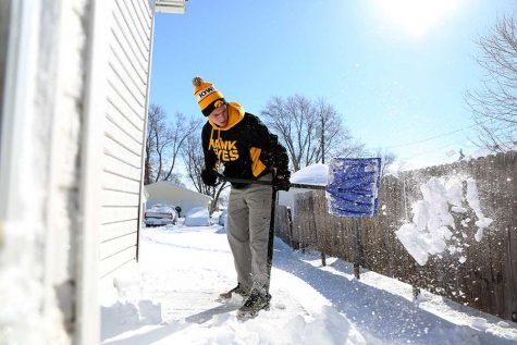 WSC student Nate Lechtenberg shovels snow that Winter Storm Selene blew around the Midwest.