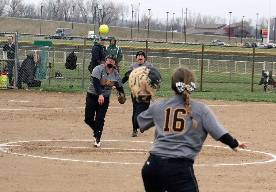 Cassy Miller, pitcher, throws to Emily Chandler, first baseman, to get an out in Sunday's game against Missouri Western. The game was the only one of the day for the Wildcats after poor weather conditions.