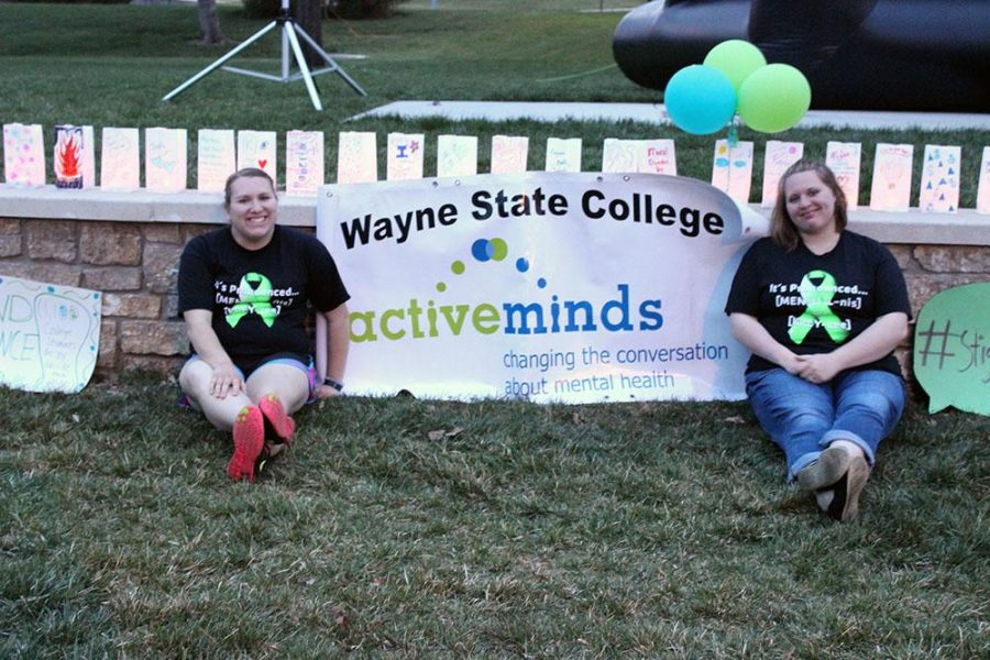 Active minds host their annual Step Against Stigma to help raise awareness of mental illness. Hailey Mills and Ciera Afrank greet people as they make lanterns.