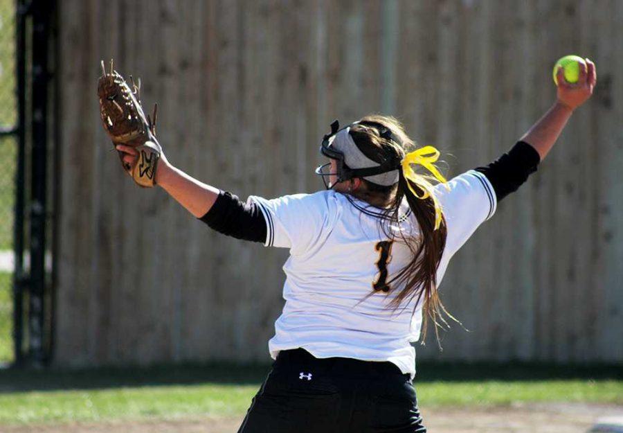 Senior+Cassy+Miller+pitches+the+softball.