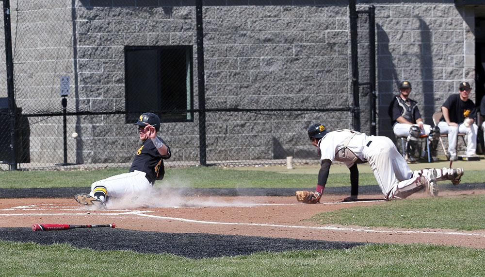 Junior Catcher Bodie Cooper sliding into home base off one of the ten Golden Eagles errors.