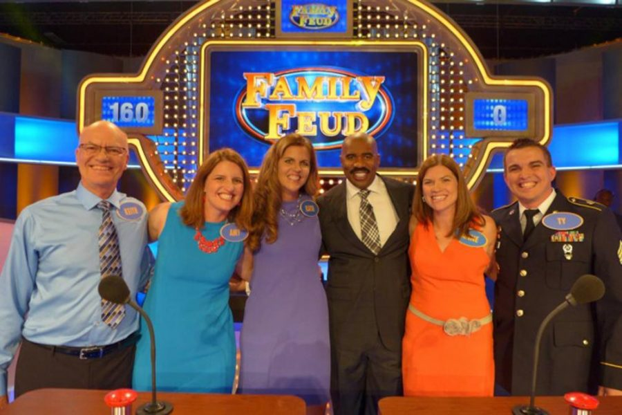 """(From left to right) Retired WSC professor Keith Willis, Amy Nordness, Katie Morrow, Host Steve Harvey, Anne Tucker and Ty Tucker all competed on """"Family Feud"""" with Willis' daughters and son-in-law."""
