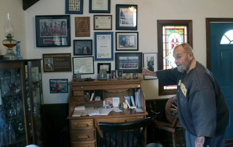 Barclay points to several photos on his wall that hold some of his greatest accomplishments, like the baton from the 1996 women's Olympic relay team that he worked with.